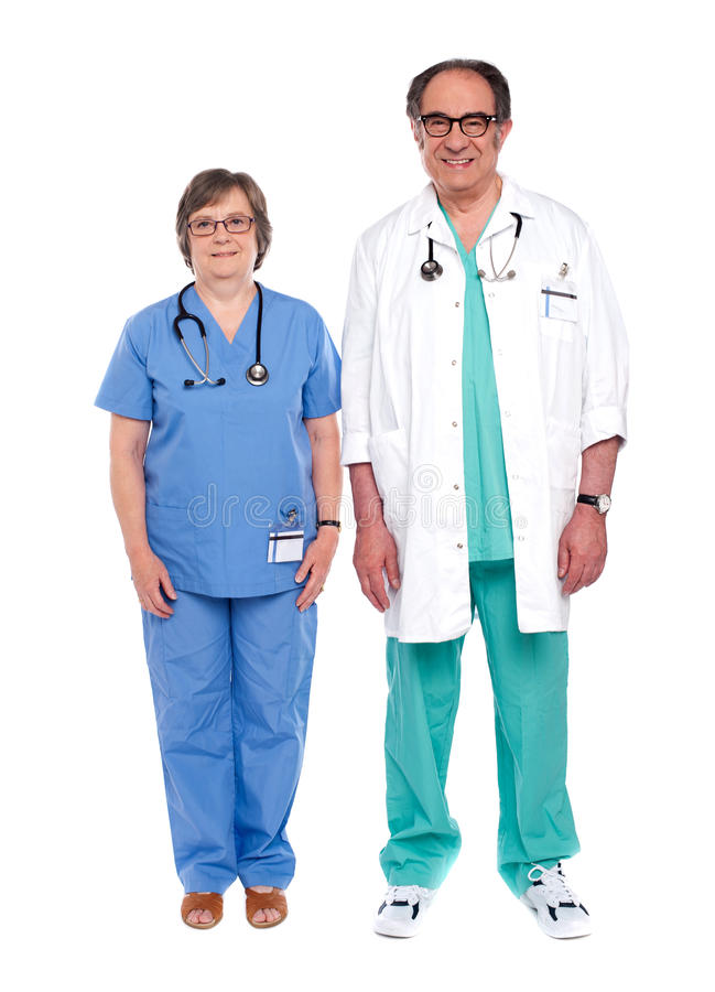 Two senior male and female physicians stock photo