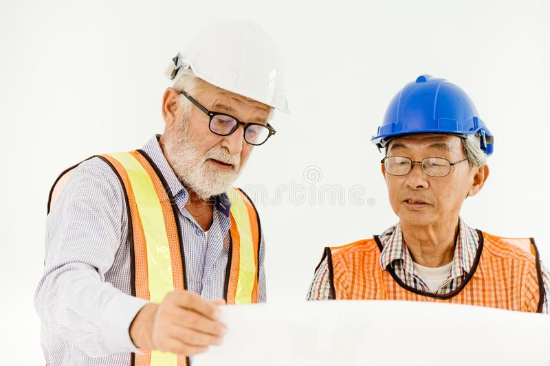 Two senior professional architecture engineer consulting with builder foreman royalty free stock photos
