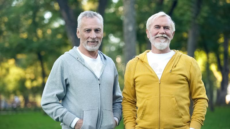 Two senior sportsmen smiling in camera, active lifestyle, health care, wellness. Stock photo stock image