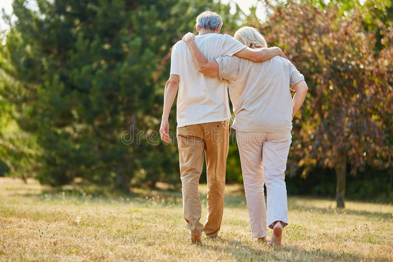 Two seniors in love walking stock image