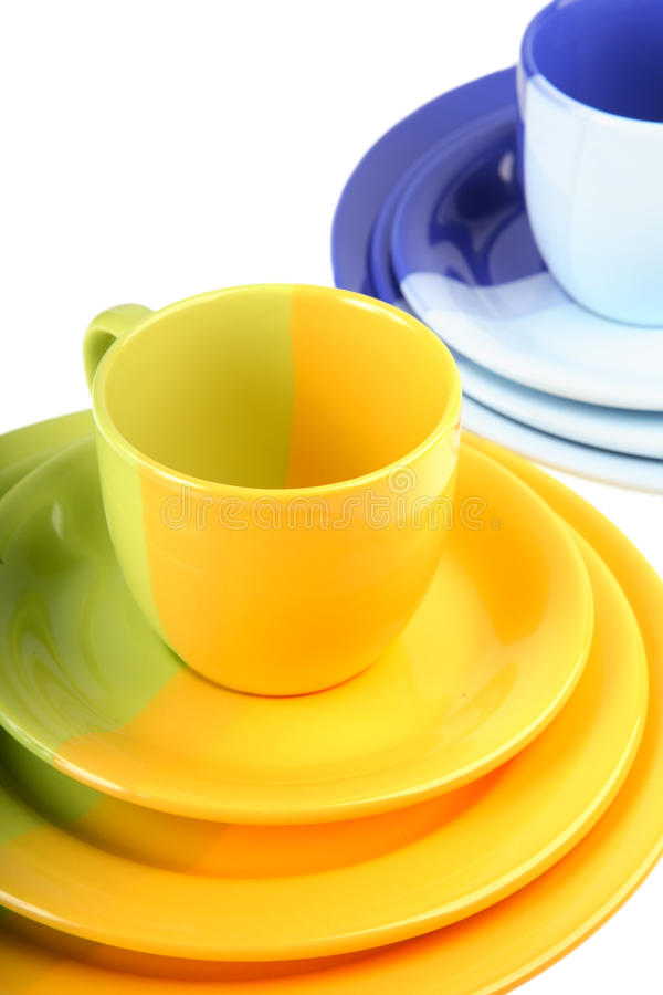 Two sets of colour ware. On a white background stock photos