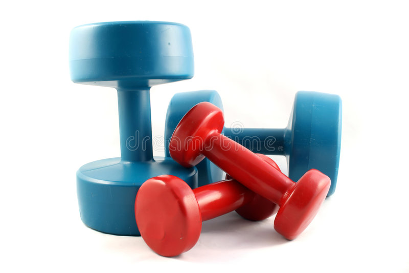 Two sets of DumbbellsDumbbells. 2 Sets of weight training Dumbbells on a white background royalty free stock images