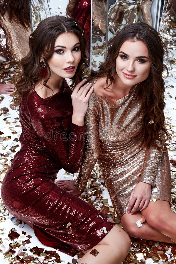 Download Two Beautiful Woman Wear Skinny Gold Red Dress Shiny Sequin Stock Photo - Image of cosmetic, brunette: 109029034