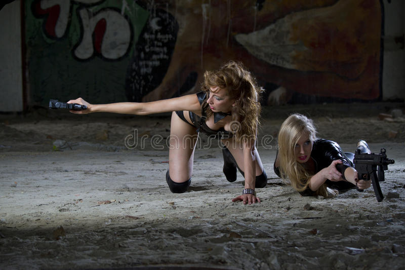 Two female spies in action stock photography