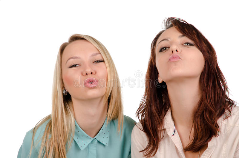 Two girls begging for a kiss royalty free stock photography