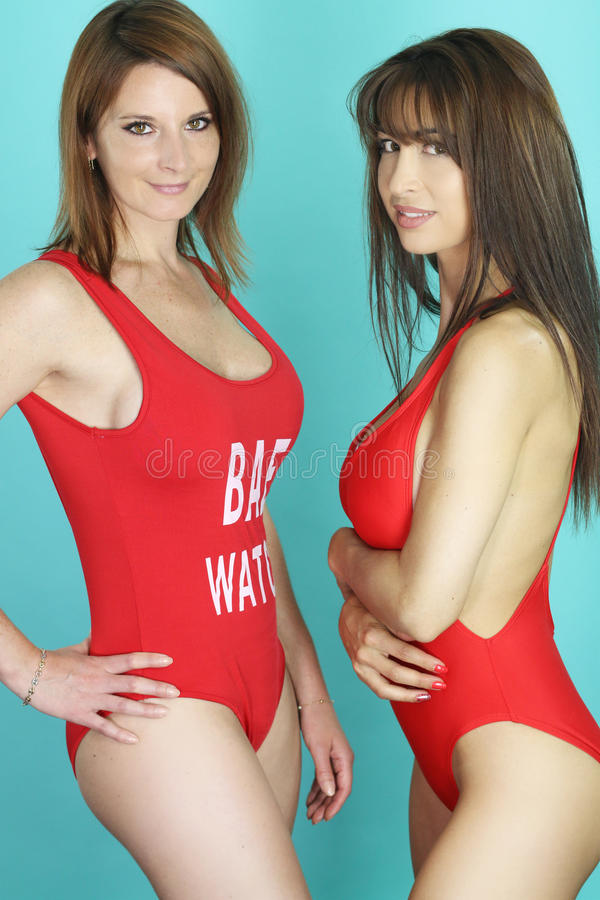 Two girls wearing a red bikini. Over a blue background stock image