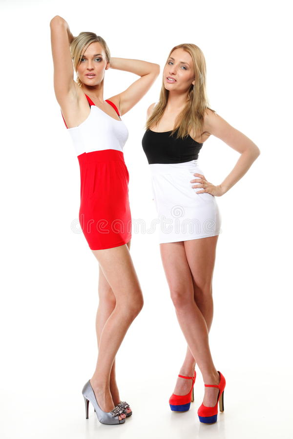 Two women wearing mini skirts. Full length two women wearing mini skirts Fashion photo, summer vacation stock photos