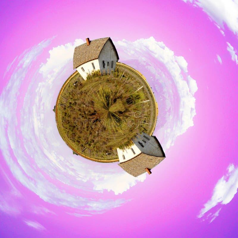Two Shacks on Tiny Planet royalty free stock photo