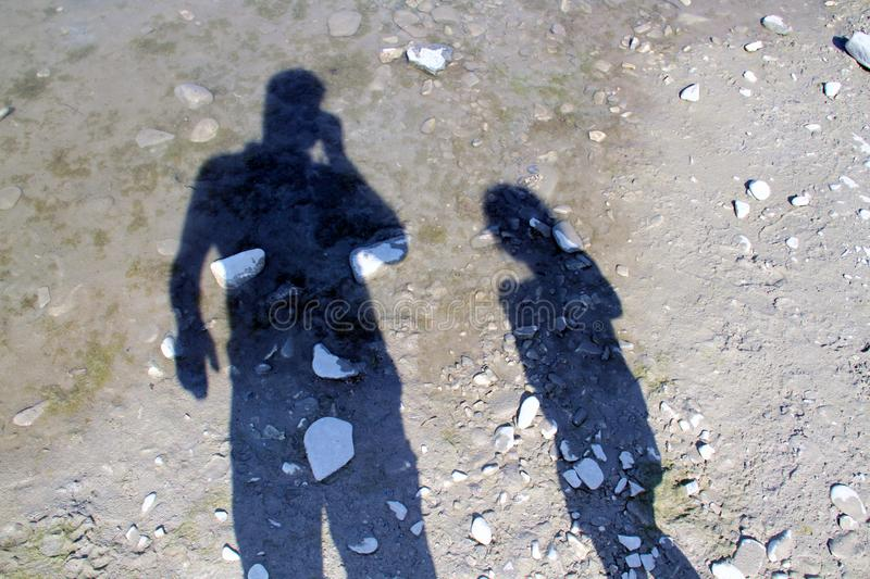 Two shadows from an adult and a child.  royalty free stock images