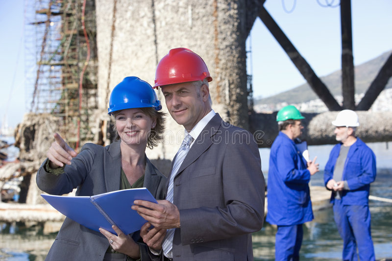 Two shipping engineers taking notes stock images