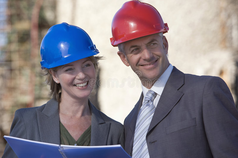 Two shipping engineers taking notes royalty free stock images