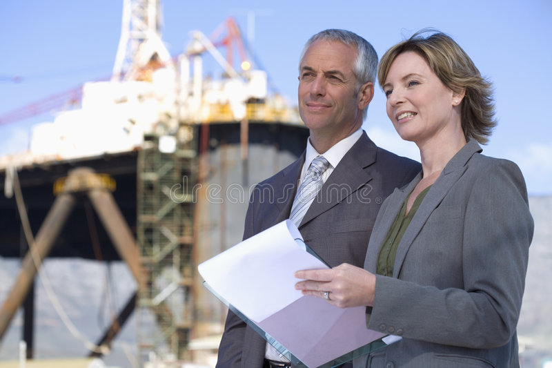 Two shipping engineers taking notes royalty free stock photo
