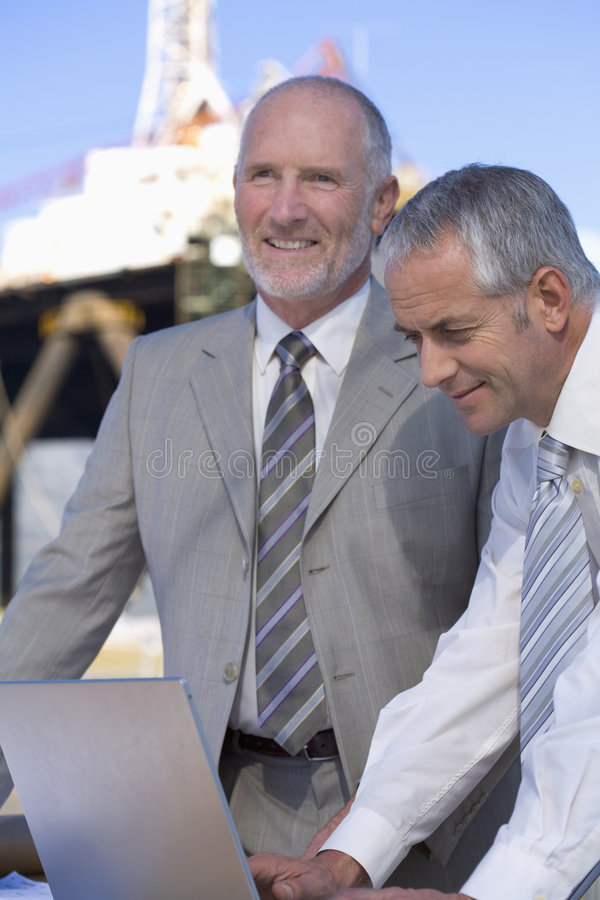 Two shipping engineers taking notes royalty free stock photos