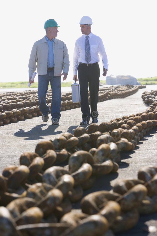 Two shipping engineers walking stock photo