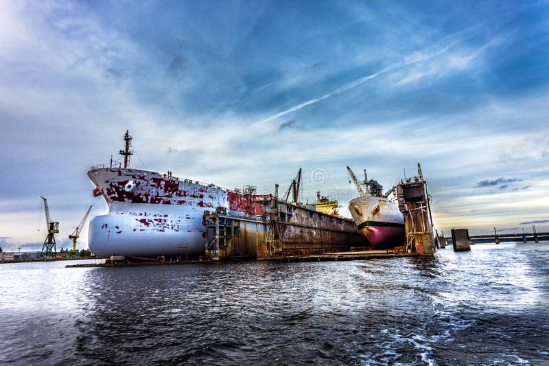 Two ships in dry repair dock royalty free stock photo
