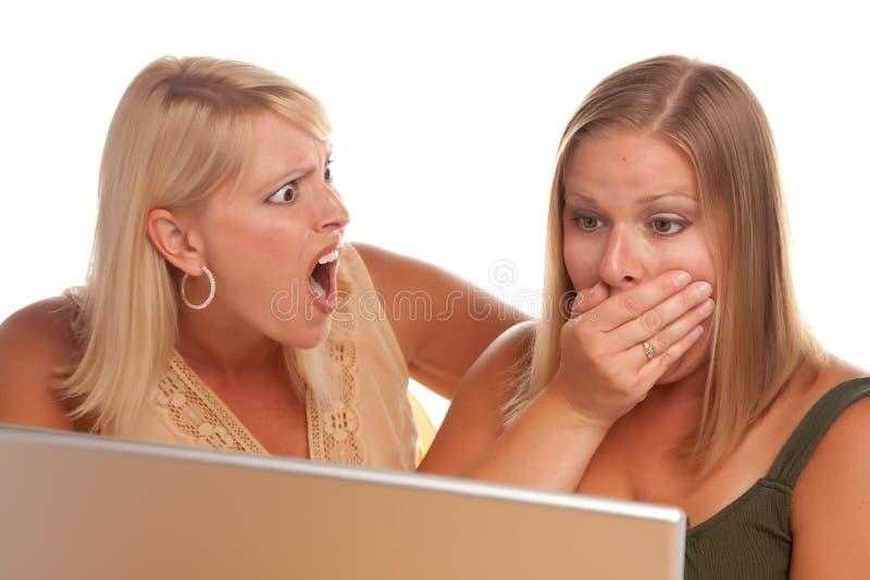 Two Shocked Women Using Laptop Stock Photos