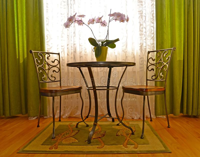 Two shod chairs and little table in an interior of a modern classical drawing room.  stock photo