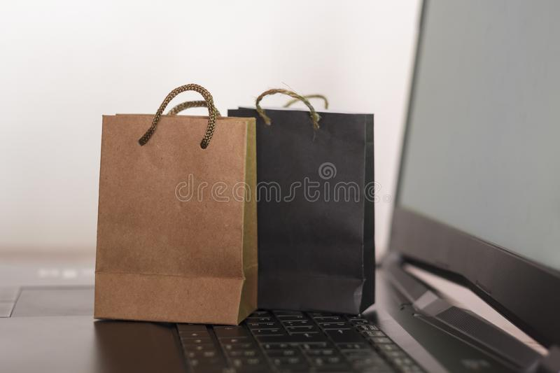 Two shopping bags on laptop. Ecommerce, online shopping concept stock photography