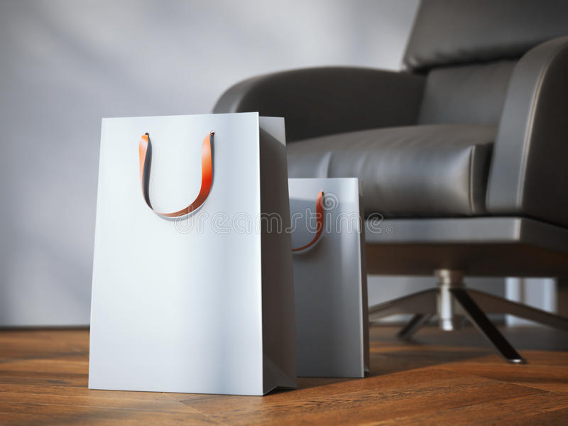 Two shopping bags near modern black armchair. 3d rendering. Two shopping bags near modern black armchair on the wooden floor. 3d rendering stock images