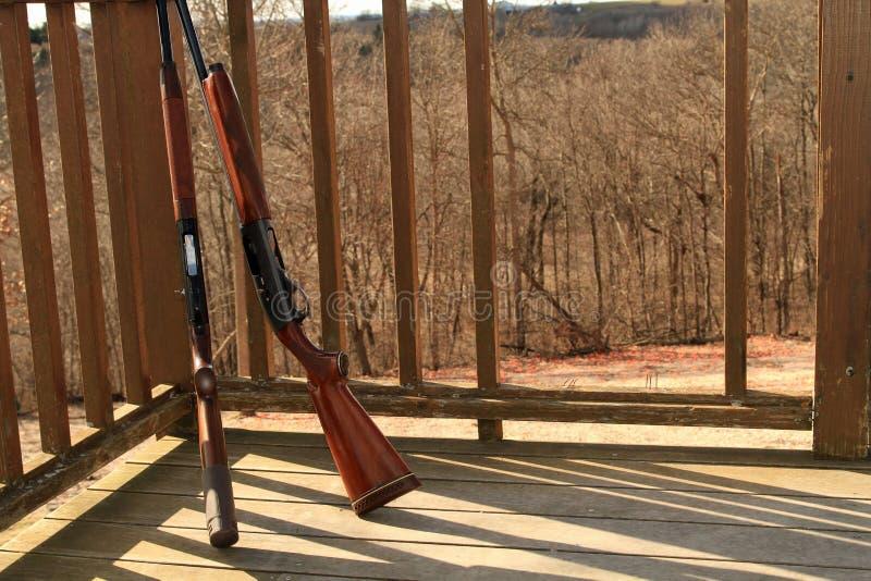 Two shot guns at sporting clay range stock image