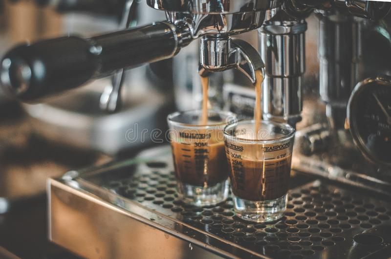 Coffee being made in Espresso Machine stock photo