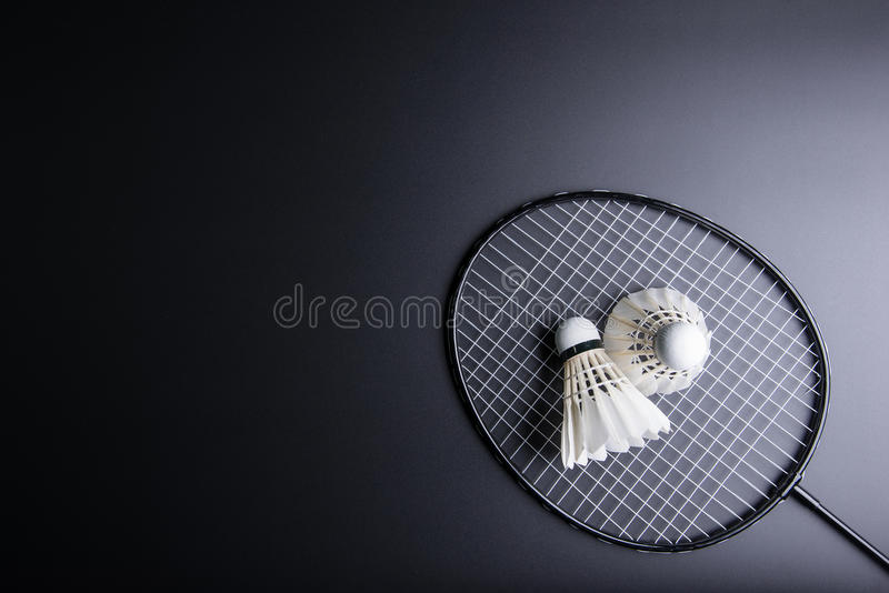 Two shuttlecocks and badminton racket on black background.Sport royalty free stock photos