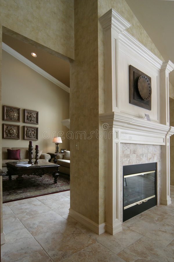Two sided fireplace and living room royalty free stock photos