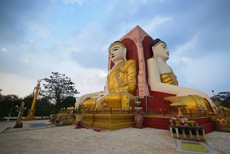 Two sides of Buddha of Kyaik Pun Pagoda Bago meditating stock photo