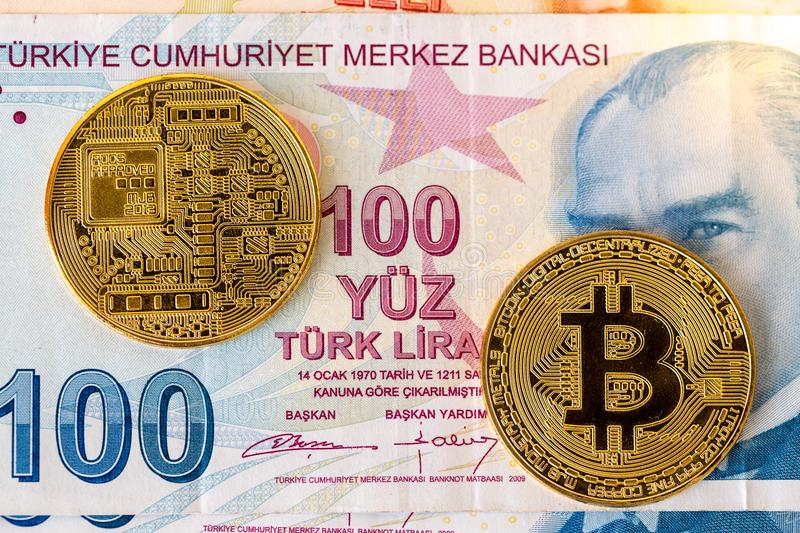 Two sides of golden physical bitcoin on turkish lira royalty free stock images