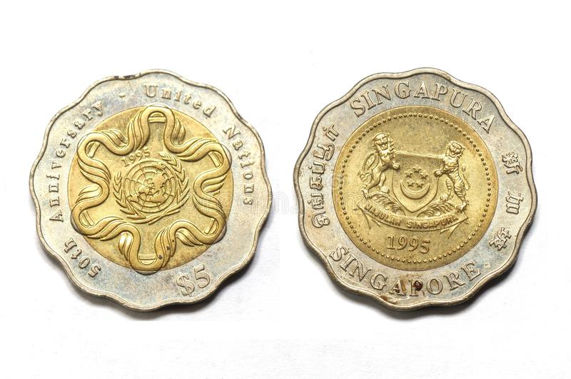 Two sides of the Singapore five dollar 50th United Nations Anniversary coin. A photo taken on the two faces of the Singapore five dollar 50th United Nations stock images