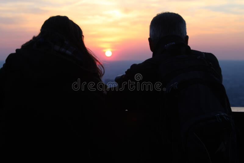 Two Silhouette Person Watching the Sunset royalty free stock image