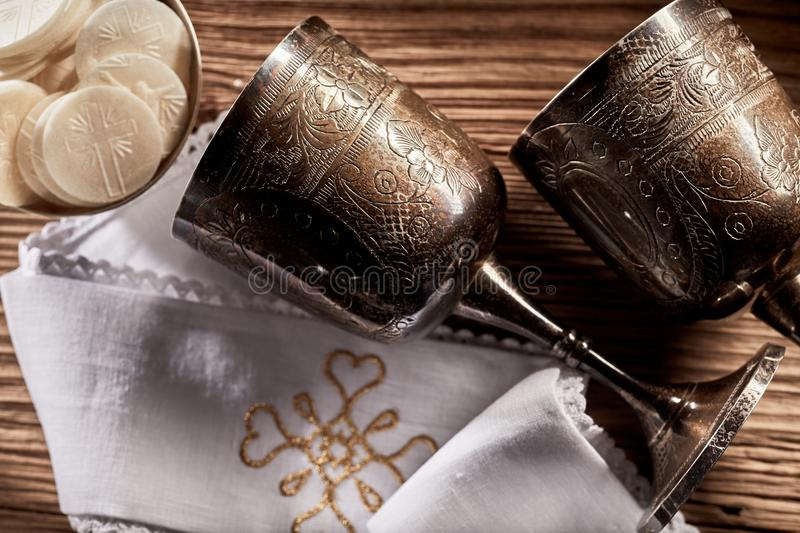 Two silver chalices and Hosties royalty free stock photo