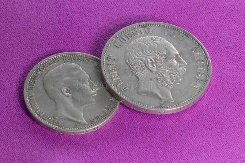 """Two silver coins  3 marks and 5 marks. Two silver coins of the 20th century, the German Empire, Prussia and Saxony, 3 marks of 1908 and 5 marks of 1902, """" royalty free stock image"""