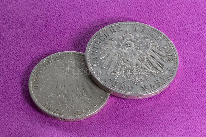 """Two silver coins  3 marks and 5 marks. Two silver coins of the 20th century, the German Empire, Prussia and Saxony, 3 marks of 1908 and 5 marks of 1902, """" royalty free stock photography"""