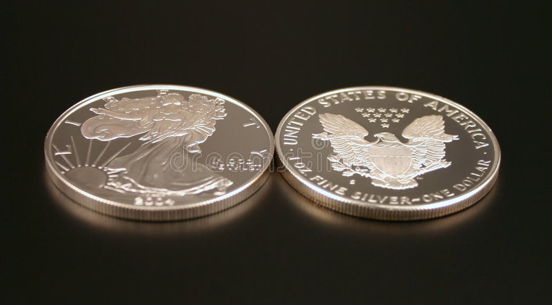Two Silver Dollars royalty free stock photos
