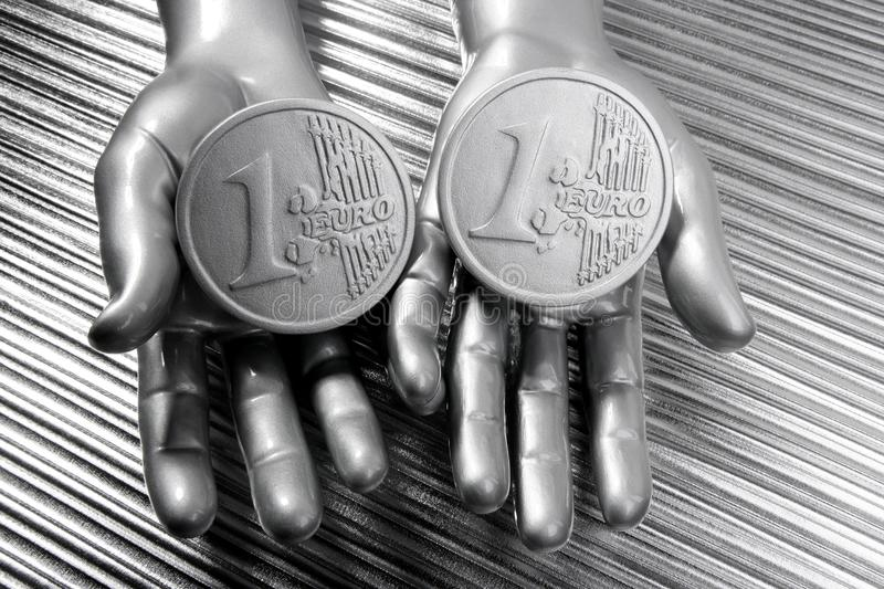 Two Silver Euro Coins In Futuristic Robot Hands Stock Photography
