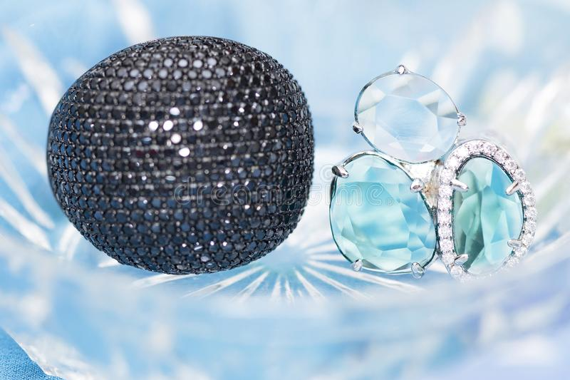 two silver rings with black cubic zirconias and semiprecious stones in crystal royalty free stock images