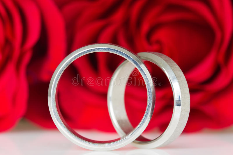 Download Two Silver Rings With Red Roses Stock Photo - Image: 27219214