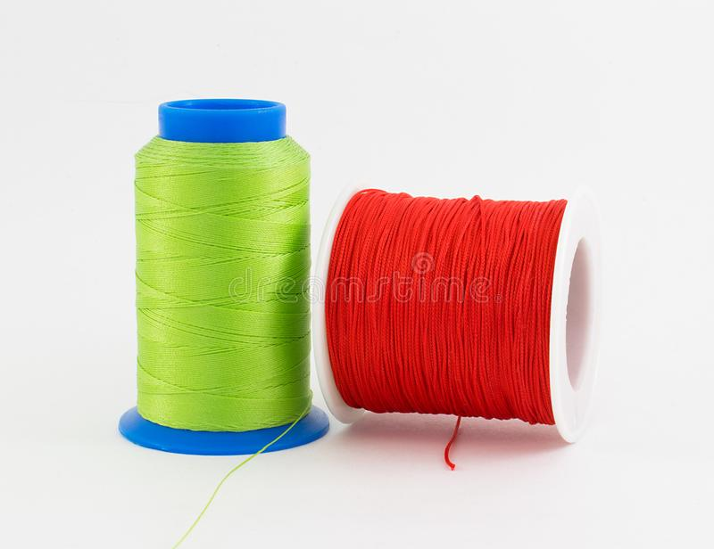 Two simple colorful thread rolls royalty free stock photo