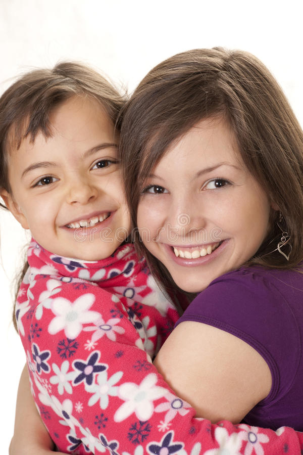 Two sisters. Embracing each other royalty free stock photography