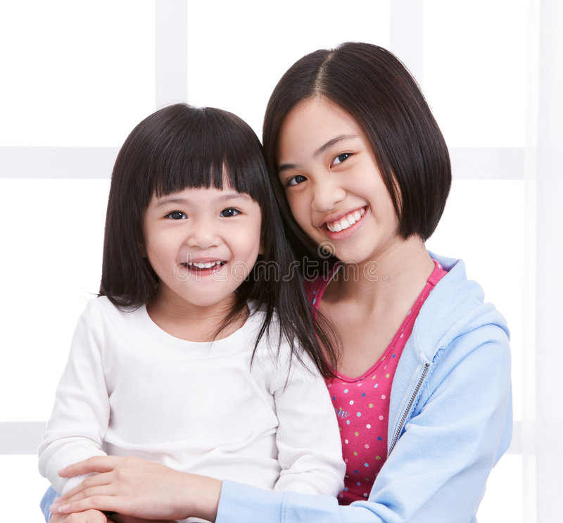 Download Two sisters stock photo. Image of smiling, white, asian - 7343978
