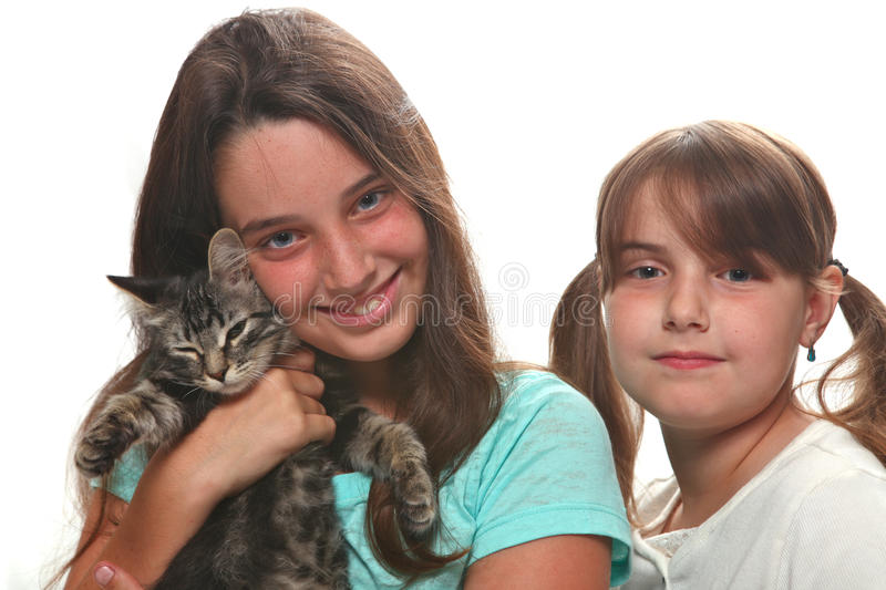 Two Sisters Holding Their Young Kitten royalty free stock photos