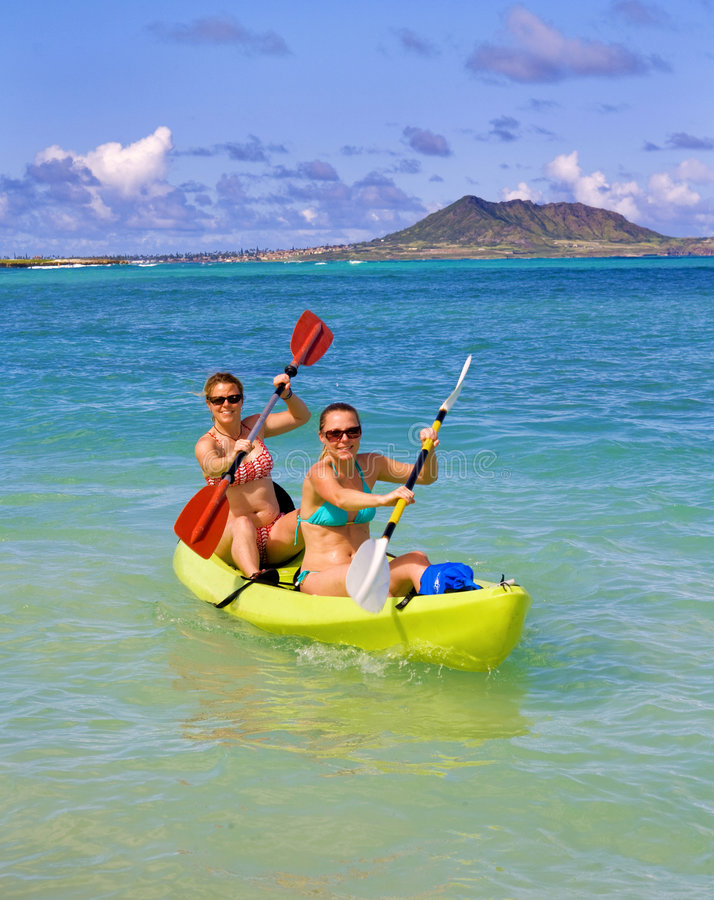 Download Two Sisters Paddling A Kayak In Hawaii Stock Photography - Image: 8009192