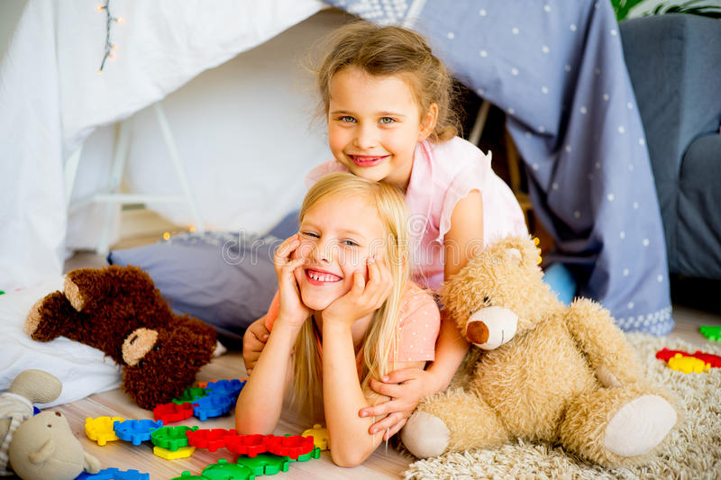 Two sisters in a play tent stock photo