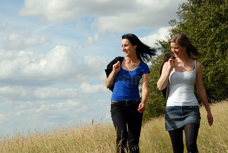 Two sisters on summer walk stock photo