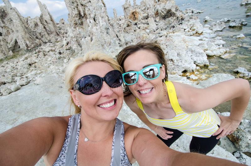 Two female friends take a selfie at the Tufa tower formations at Mono Lake in California`s eastern Sierra, located off of US-395 stock photos