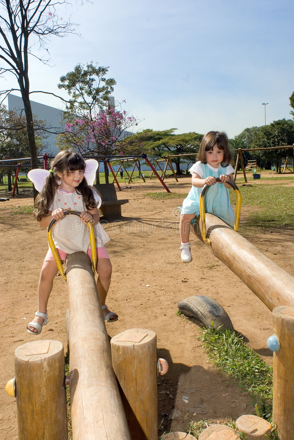 Download Two Sisters On Teeter Totters Stock Image - Image: 5354547