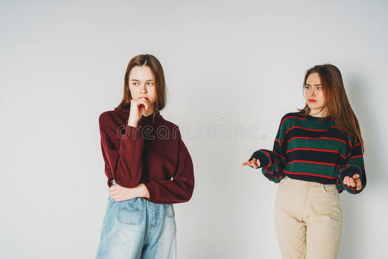 Two sisters twins beautiful girls hipsters in casual clothing on royalty free stock photo