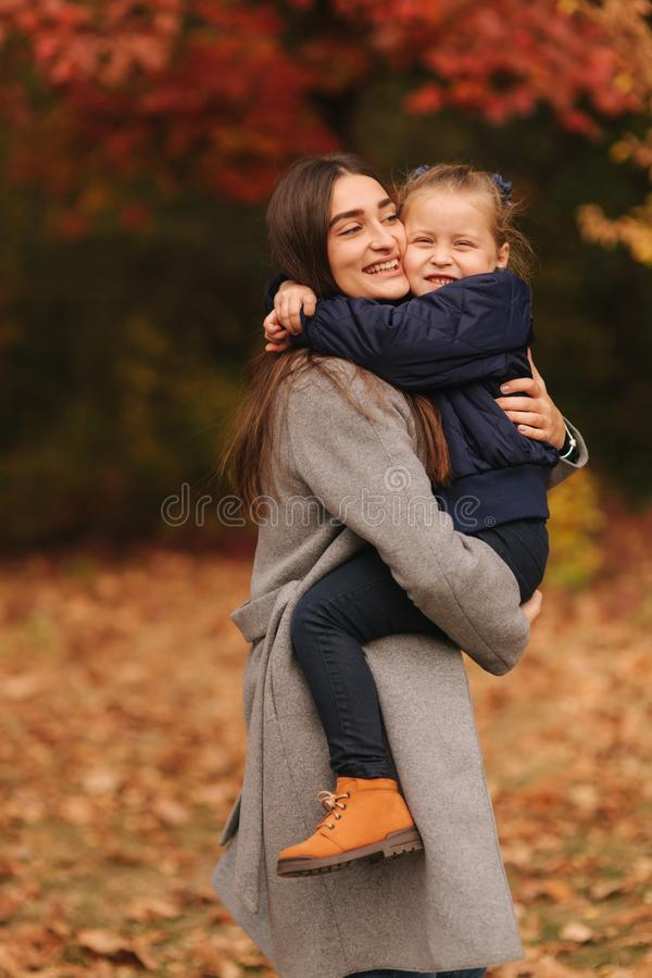 Two sisters walk in the park in autumn time. Childhood. season and people consept-happy family. Portrait of happy stock photography
