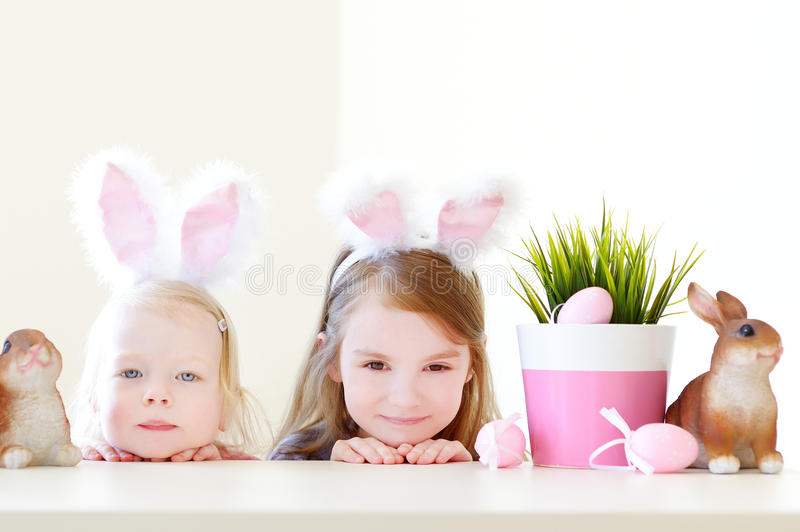 Two sisters wearing bunny ears on Easter. Two adorable little sisters wearing bunny ears on Easter day royalty free stock photography
